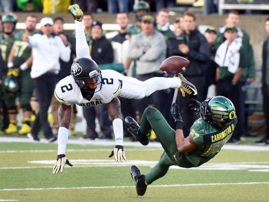 Oregon wide receiver Darren Carrington (87) catches the ball as Colorado cornerback Kenneth Crawley (2) defends during the second quarter of an NCAA college football game on Saturday, Nov. 22, 2014, in Eugene, Ore. (AP Photo/Steve Dykes)