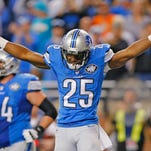 Detroit running back Theo Riddick celebrates after scoring the game-winning touchdown on an 11-yard pass from quarterback Matthew Stafford with 29 seconds left in Sunday's game against Miami at Ford Field in Detroit.