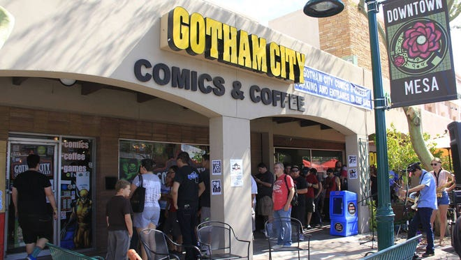 Fans line up for Free Comic Book Day in 2015 at Gotham City Comics & Coffee in Mesa.