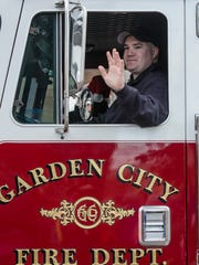 Garden City fire trucks add color and sirens to the parade.