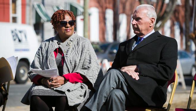 City Council President Hanifa Shabazz and Mayor Mike Purzycki attend a demolition nuisance and abandoned properties in the area of 8th and Bennett Streets on the Eastside of Wilmington.