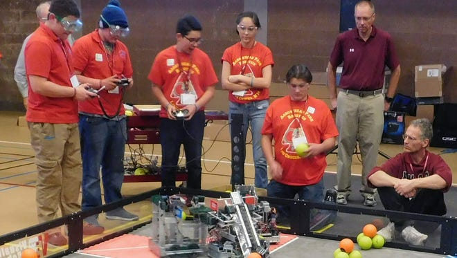Arrowhead Park Early College High students maneuver robots they designed and built on playing field for the VEX State Championship. Seven New Mexico teams won the rights to compete in VEX Worlds this week.