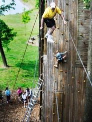 Try out the high ropes course during open climb at