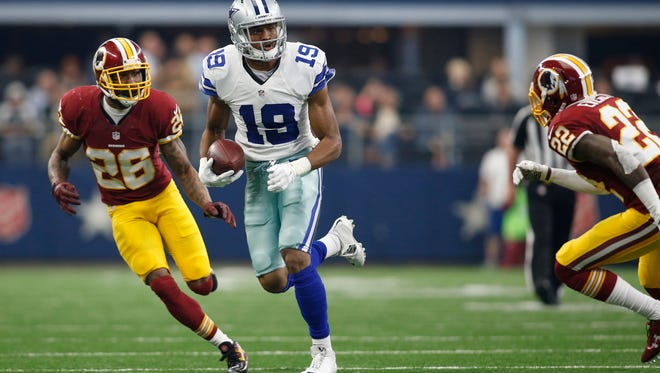 Dallas Cowboys wide receiver Brice Butler (19) runs the ball after catching a pass against Washington Redskins cornerback Bashaud Breeland (26) and cornerback Deshazor Everett (22) in the second quarter at AT&T Stadium.