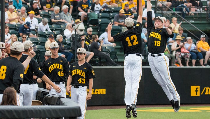 Iowa's Nick Nelsen and Shane Ritter high-five during