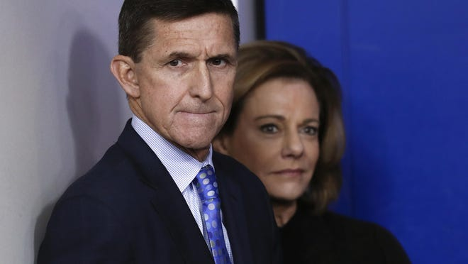 This Feb. 1, 2017, file photo shows National Security Adviser Michael Flynn, joined by K.T. McFarland, deputy national security adviser, during the daily news briefing at the White House, in Washington.