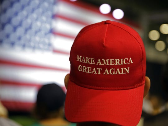 A supporter of then-candidate Donald Trump wears a Make America Great Again cap at a 2016 rally in Westfield, Indiana.