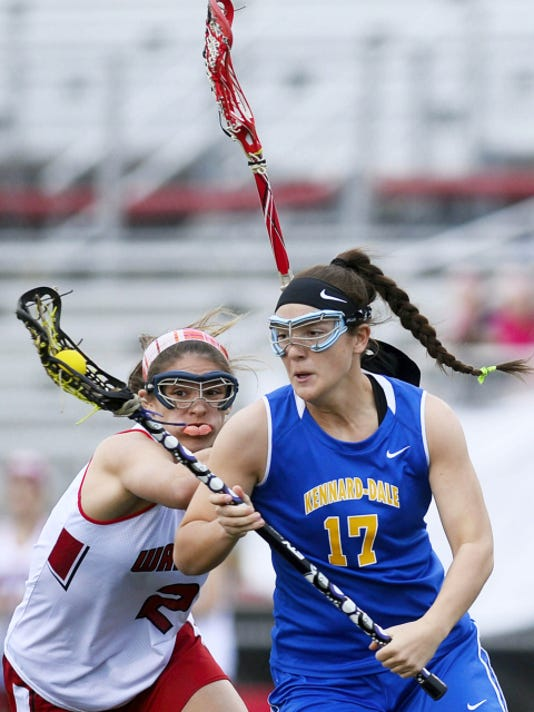 Kennard-Dale's Lyndsey Duty, right, moves toward the net against the defense of Susquehannock's Haley Martinez during Thursday's lacrosse match at Susquehannock. Duty scored a goal and added an assist to help Kennard-Dale win 11-6.