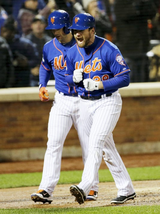 The Mets' Daniel Murphy celebrates after hitting a two-run home run during the first inning Sunday night. It was his fourth-straight playoff game with a homer.