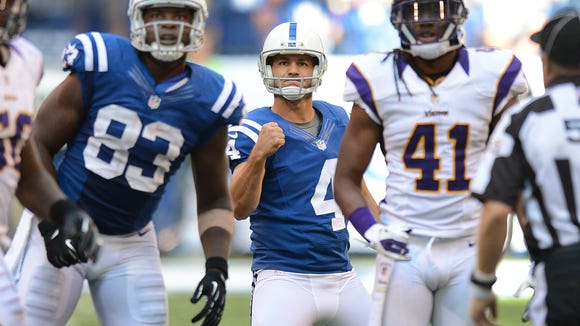 Indianapolis Colts kicker Adam Vinatieri pumps his fist as he watches his game winning 53-yard field goal split the uprightsto defeat the Minnesota Vikings Sunday, September 16, 2021, afternoon at Lucas Oil Stadium. Matt Kryger / The Star