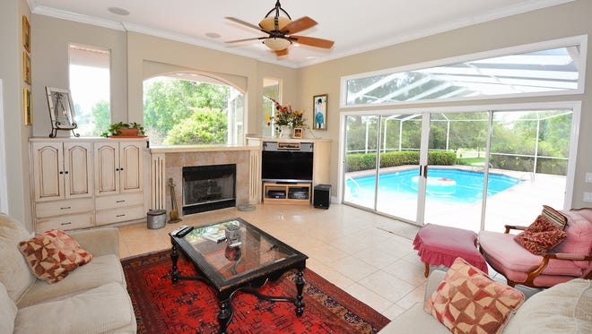 3048 Cobblestone Drive, the family room offers access to the pool deck.