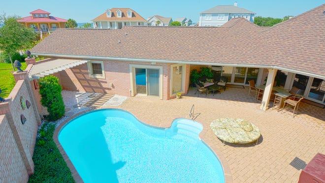 513 Windrose Circle, pool view.