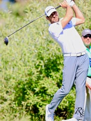 Aaron Rodgers watches his shot on Friday at Edgewood