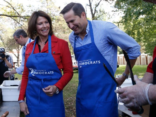 U.S. Rep. Cheri Bustos (D-IL) puts on her glove as