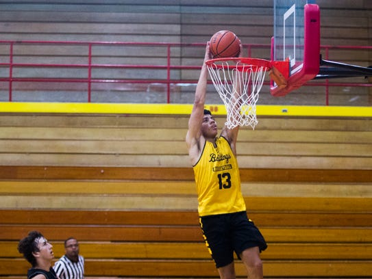 Bettendorf point guard D.J. Carton dunks during a basketball