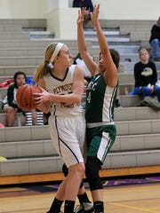 Taylor Mistele of Plymouth Christian (left) tries to
