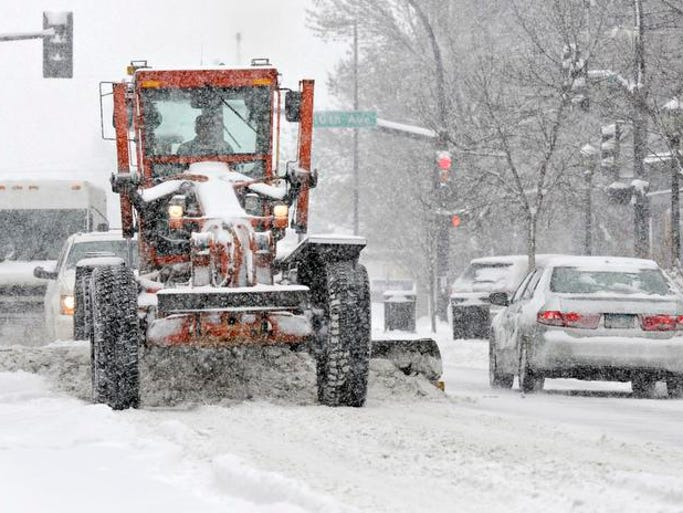 St. Cloud Street Department workers were busy clearing snow on St. Germain Street and around the city Tuesday.