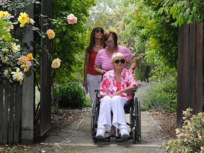 Marisa Evans, Isabel Pimentel and Mimi Hoffman travel from one  garden to the next at Hoffman's two-acre Tulare property she calls home. Her gardens will be featured in the Valley Oak Garden Club Garden Tour April 26.