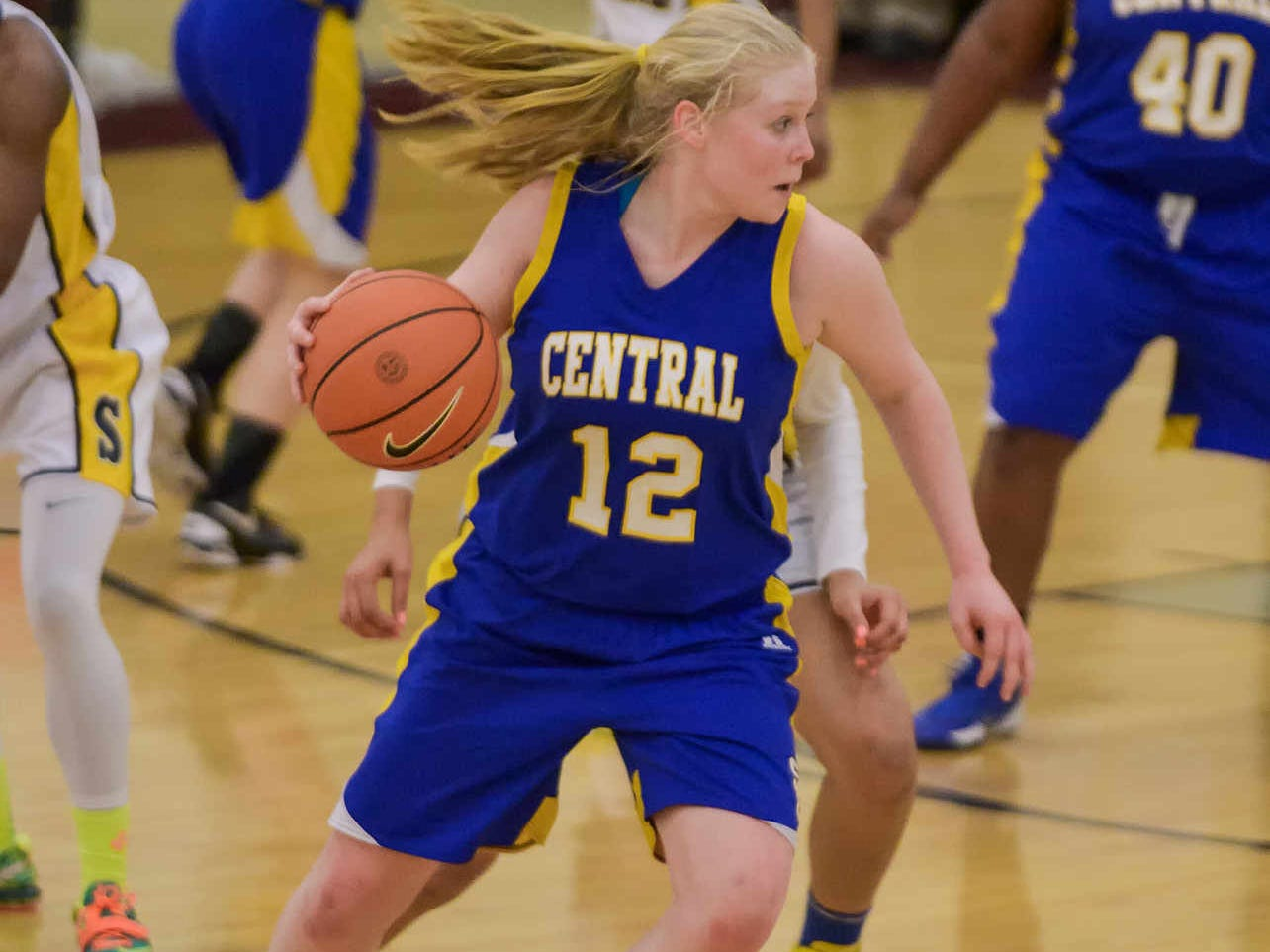 Emily Truitt (#12, Sussex Central) takes the ball down the court. DIAA girls basketball quarterfinal between Sanford and Sussex Central. DOUG CURRAN/SPECIAL TO THE NEWS JOURNAL