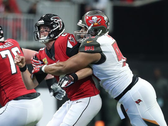 Nov 24, 2019; Atlanta, GA, USA; Atlanta Falcons quarterback Matt Ryan (2) is hit after a pass attempt by Tampa Bay Buccaneers nose tackle Ndamukong Suh (93) in the second half at Mercedes-Benz Stadium. Mandatory Credit: Jason Getz-USA TODAY Sports