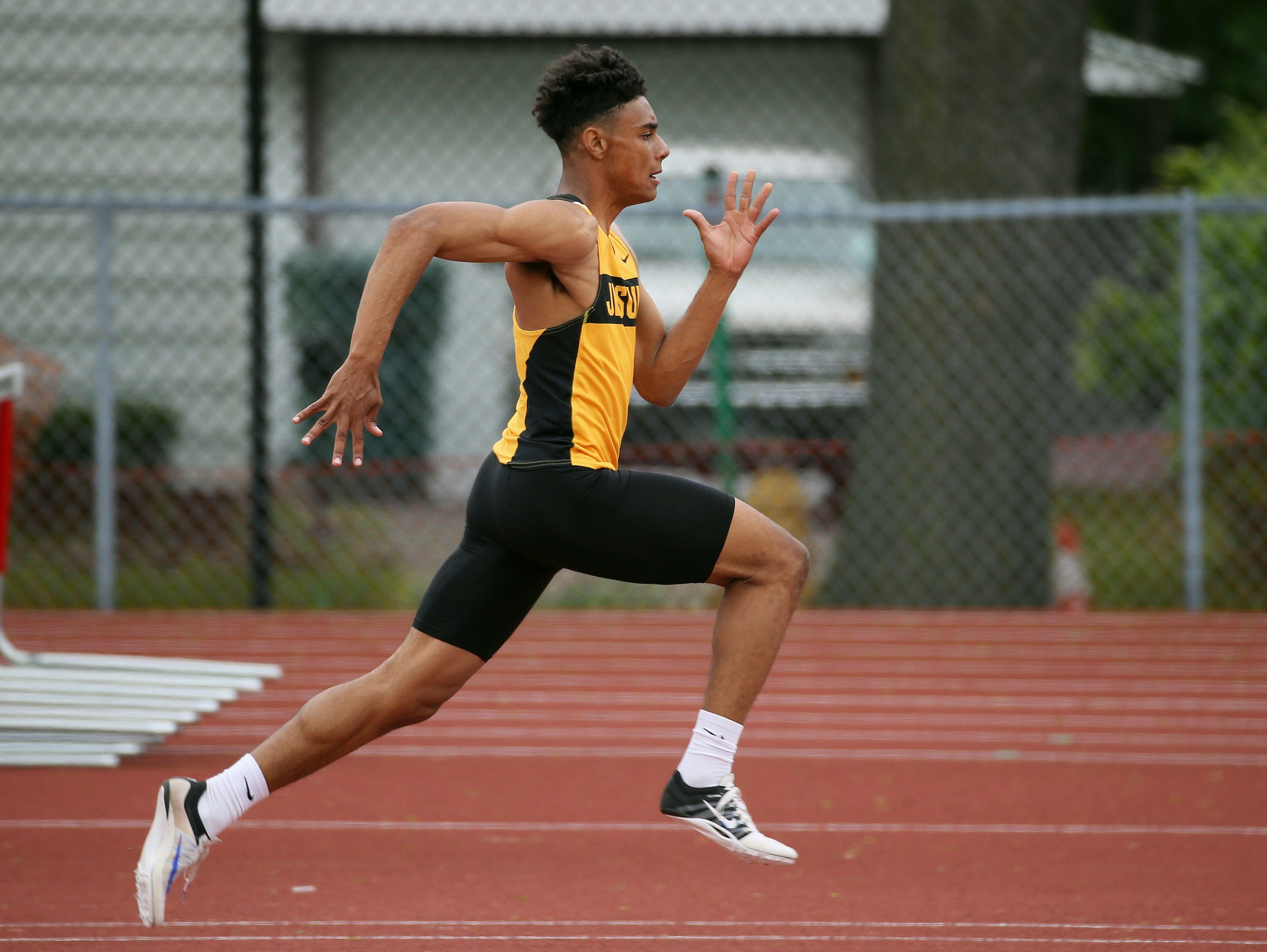 McQuaid's Noah Williams competes in the long jump event