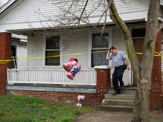 Evansville crime scene investigator Phil Luecke exits