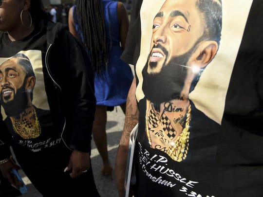 Guests wear t-shirts in tribute to Nipsey Hussle, whose given name was Ermias Asghedom, at the late rapper's Celebration of Life memorial service on Thursday, April 11, 2019, at the Staples Center in Los Angeles.