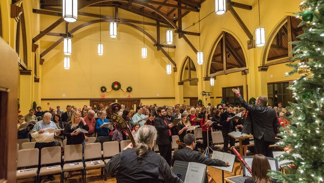 """A near-capacity crowd filled St. Thomas Episcopal Church in Terrace Park when the church hosted a pair of singalong performances of """"Messiah"""" in 2016. This year's singalong takes place Dec. 18."""