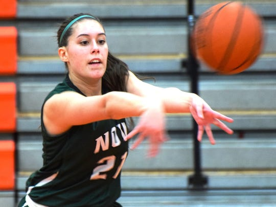 Novi's Carson Garguilo fires a pass in Friday's 46-37 win at Northville.