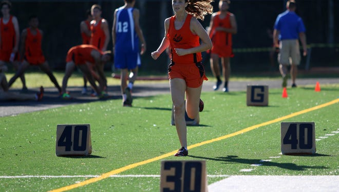 Rosie Poling races toward the finish line during Friday morning's District 2A-12 meet at Lely High School.