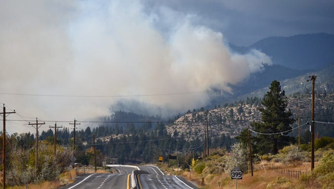 Smoke from the Little Valley Fire billows over Washoe Valley south of Reno on Friday, Oct. 14, 2016.