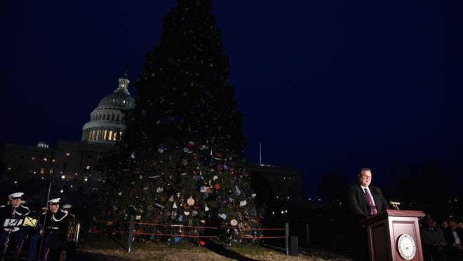 Senator Jon Tester, D-Mont., speaks at the tree lighting ceremony for the Capitol Christmas Tree. This year's tree was a 79-foot Engelmann Spruce from the Kootenai National Forest in Montana.