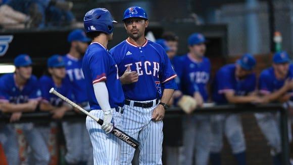 Louisiana Tech head baseball coach Lane Burroughs, right, talks with Mason Mallard (5) earlier this season.