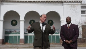 Detroit Mayor Mike Duggan and Councilman Roy McCalister Jr. speak during a 2018 news conference near the Coliseum at the former Michigan State Fairgrounds. The property is now owned by the city of Detroit, with a portion purchased by a development company headed by Magic Johnson.