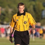 Tyler Winningham works a soccer game during the 2015 Canton Cup. He also plays and coaches the sport, giving him a unique perspective on the way officials are treated.