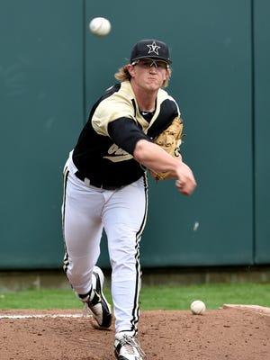 Vanderbilt pitcher Carson Fulmer throws in the bullpen Friday.