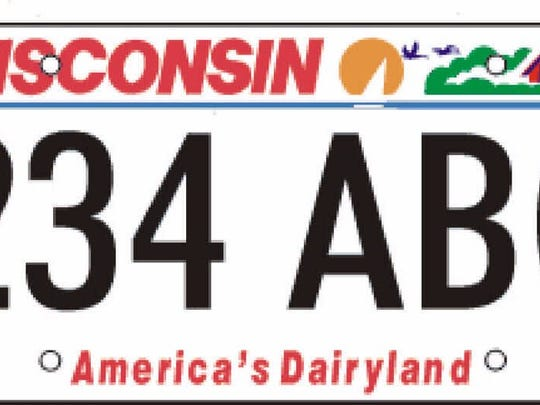 Gov. Scott Walker said the Wisconsin license plates are fine the way they are.