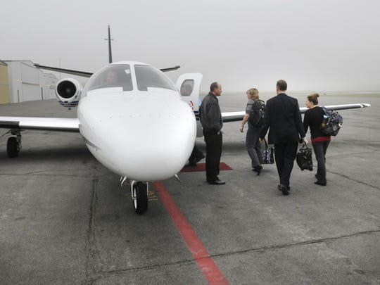 Coborn's employees board a plane May 6 at the St. Cloud Regional Airport bound for Williston, N.D.