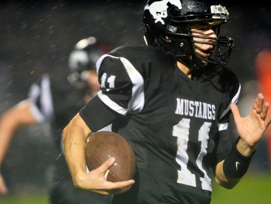 South Western quarterback Brock Geiman carries the ball in the second half of a football game at South Western on Friday. The Mustangs defeated the Lions 20-0 to win their homecoming game. (Chris Dunn -- GameTimePA.com)