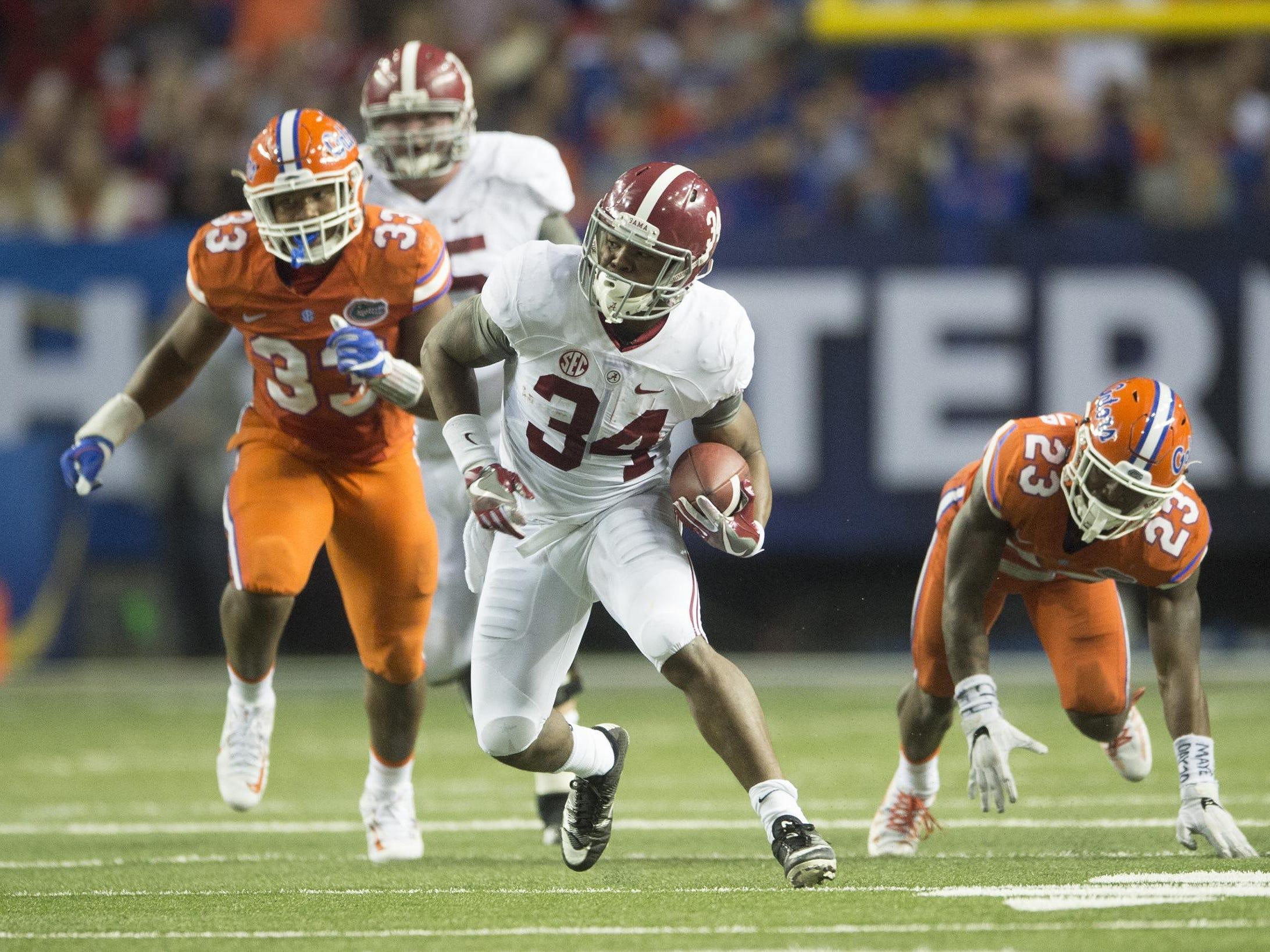 Alabama running back Damien Harris (34) runs downfield during the SEC Championship football game between Alabama and Florida on Saturday, Dec. 3, 2016, in Atlanta, Ga. Alabama defeated Florida 54-16.