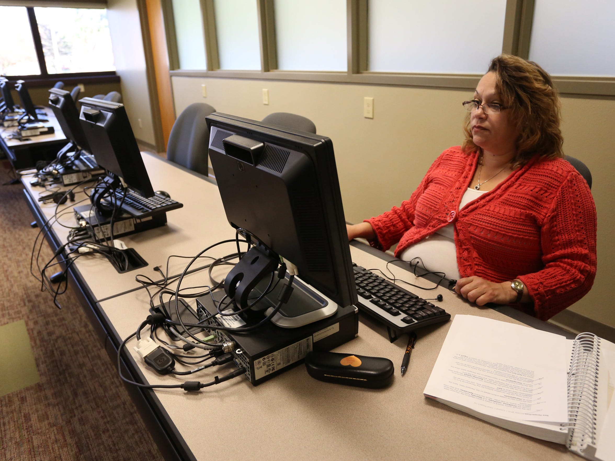 Lisa Rios works at a computer during one of her classes