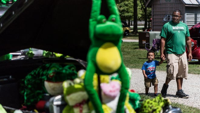 Derrick Naylor and his son Marshall Naylor, 1, walk around the Vanderburgh County 4-H Center fairground as they look at hot rods during the last day of the 43rd Annual Frog Follies on Sunday afternoon, Aug. 27, 2017.