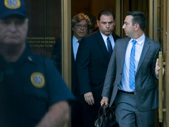 Joseph Percoco, center, exits the Thurgood Marshall U.S. Courthouse in Manhattan following a hearing in 2017.