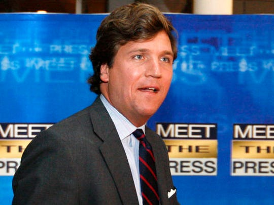 FILE - In this Nov. 17, 2007 file photo, political commentator Tucker Carlson arrives for the 60th anniversary celebration of NBC's Meet the Press at the Newseum in Washington. Fox News Channel says that veteran pundit Carlson will replace Megyn Kelly in the network's coveted 9 p.m. time slot sandwiched between Bill O'Reilly and Sean Hannity. Kelly announced on Tuesday, Jan. 3, 2017, that she is leaving Fox to go to NBC News.  (AP Photo/Charles Dharapak, File)