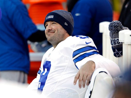 FILE - In this Jan. 1, 2017, file photo, Dallas Cowboys' Tony Romo smiles on the bench during the second half of an NFL football game against the Philadelphia Eagles in Philadelphia. A person with knowledge of the decision says Romo is retiring rather than trying to chase a Super Bowl with another team after losing his starting job with the Dallas Cowboys. The all-time passing leader for the storied franchise is headed to the broadcast booth after considering those offers. The person spoke to The Associated Press on condition of anonymity Tuesday, April 4, 2017, because Romo's decision hasn't been announced.