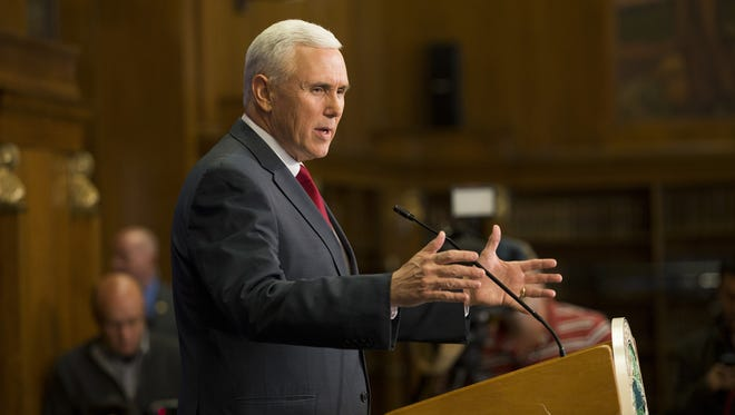 Indiana Gov. Mike Pence holds a press conference Tuesday at the Indiana State Library in Indianapolis.