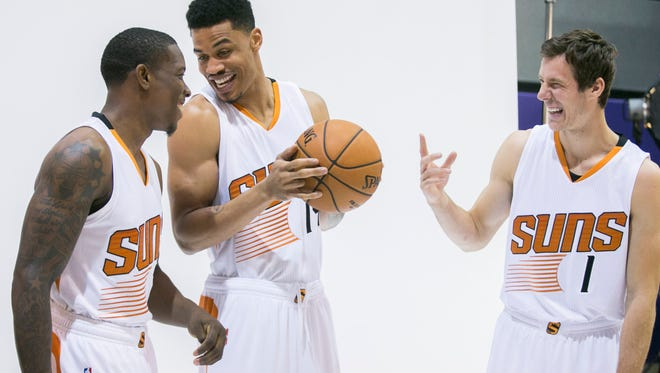 Suns' Eric Bledsoe (L-R), Gerald Green and Goran Dragic joke around in front of the cameras during media day at US Airways Center in Phoenix, AZ on Monday, Sept. 29, 2014.