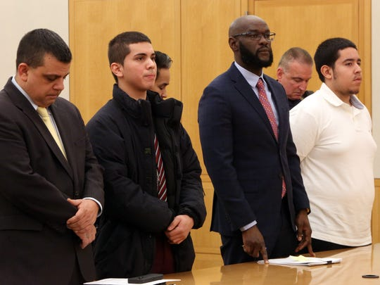 Attorney Anthony Mattesi, left, with client Jerry Reyes, attorney Eon Smith with client Frank Valencia at the arraignment in the shooting of Yonkers Police officer Jan. 16, 2018 at Westchester County Court in White Plains.