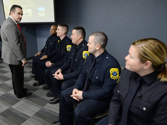 The Green Bay Police Department swore in five new officers April 6, 2015. Mayor Jim Schmitt talks with the new officers before the ceremony began.