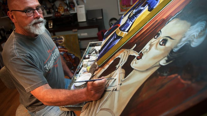 Artist Mike Bell works on a painting in the studio of his Northfield home. Bell's work is greatly inspired by growing up near the Atlantic City Boardwalk.